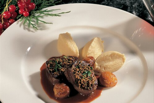 Venison with walnut and herbs in grappa sauce